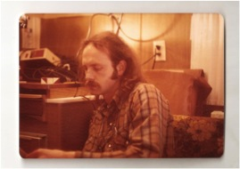 Joe in the first mobile split-brain testing lab; a camper trailer outfitted with a tachistascope. Probably 1975 somewhere in Vermont