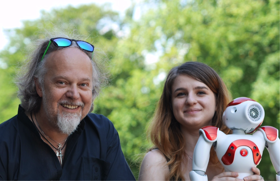 Arvid with his former student Alina Dinu and Nao the Robot