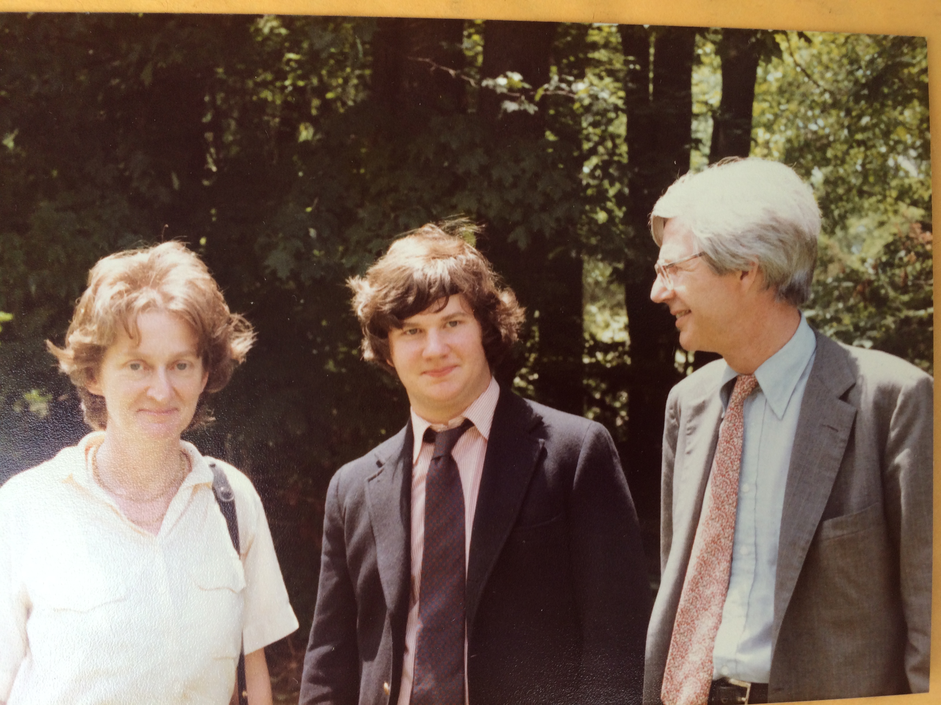 Justin at high school graduation with his parents in 1981